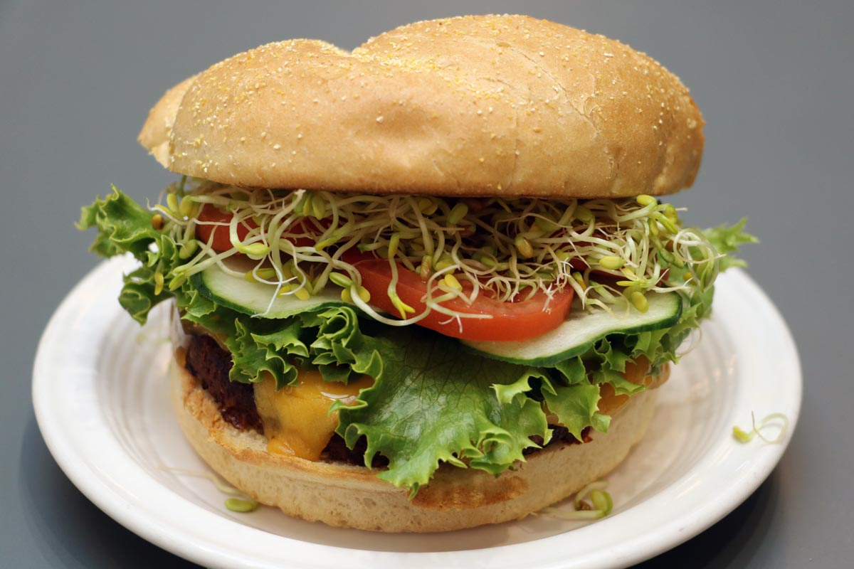 Veggie Burger, with cheese and vegetable toppings on a bun.