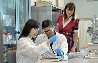 At right, Catherine Best, a research assistant professor of bioengineering, supervises students, including REU participant Javier De Jesus Astacio, center, who will start his third year in mechanical engineering at the University of Puerto Rico at Mayaguëz, and  Yujin Lee, an Illinois junior in bioengineering.