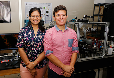 Shachi Mittal, a Beckman Institute Graduate Fellow, (left), and Juan Munoz, a junior in biomedical engineering at Mercer University