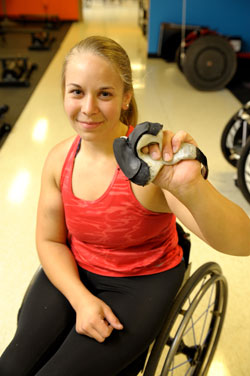 Arielle Rausin with her wheelchair racing gloves