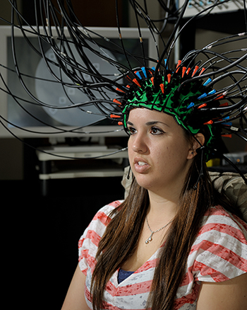 A student having her brain imaged using optical techniques