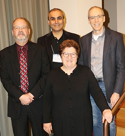 Pictured: front row, Zan Luthey-Schulten, a professor of chemistry and Schulten's widow; back row, from left, Mark Berger, senior alliance manager for life and material sciences, NVIDIA; Emad Tajkhorshid, a professor of biochemistry and leader of the Theoretical and Computational Biophysics Group;  and Jeff Moore, the director of the Beckman Institute for Advanced Science and Technology.