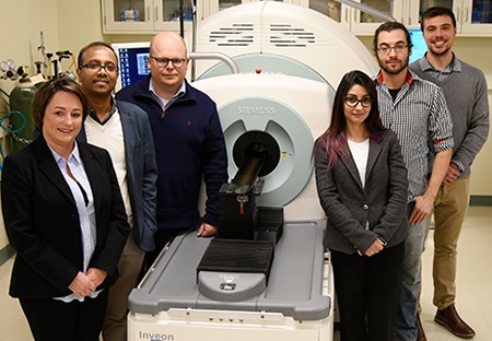 Collaborators on the article, pictured in the Molecular Imaging Lab at the Beckman Institute: from left, Iwona T. Dobrucka, Dipanjan Pan, Wawrzyniec Dobrucki, Jamila Hedhli, Aaron Schwartz-Duval, and Christian J. Konopka.