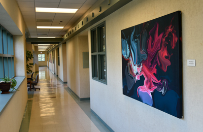 A photo of the painting called Amorphous shown hanging in the northeast hallway of the second floor.