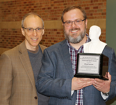 Jeff Moore (left), director of the Beckman Institute, poses with Brad Sutton, a professor of bioengineering and the technical director of the Biomedical Imaging Center at the Beckman Institute, during a reception celebrating Arnold Beckman's birthday and Sutton being awarded the 2018 Beckman Institute for Advanced Science and Technology Vision and Spirit Award.