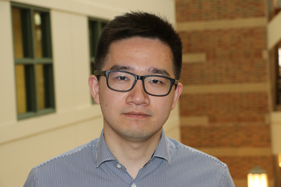 Photo of Beckman Institute Postdoctoral Fellow Xing Jiang at the institute.