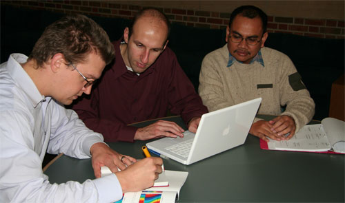 Beckman Institute faculty member Scott Carney, at far left, works with graduate students Robert Schoonover, center, and Budiman Dabarsyah. All three are either current or former Fulbright scholars.