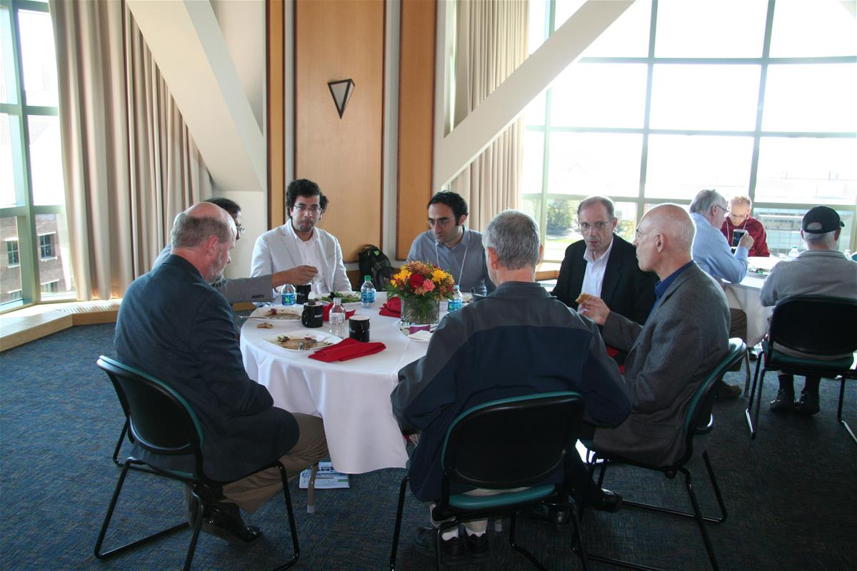 A research group talks over lunch catered in Beckman's fifth-floor tower room.