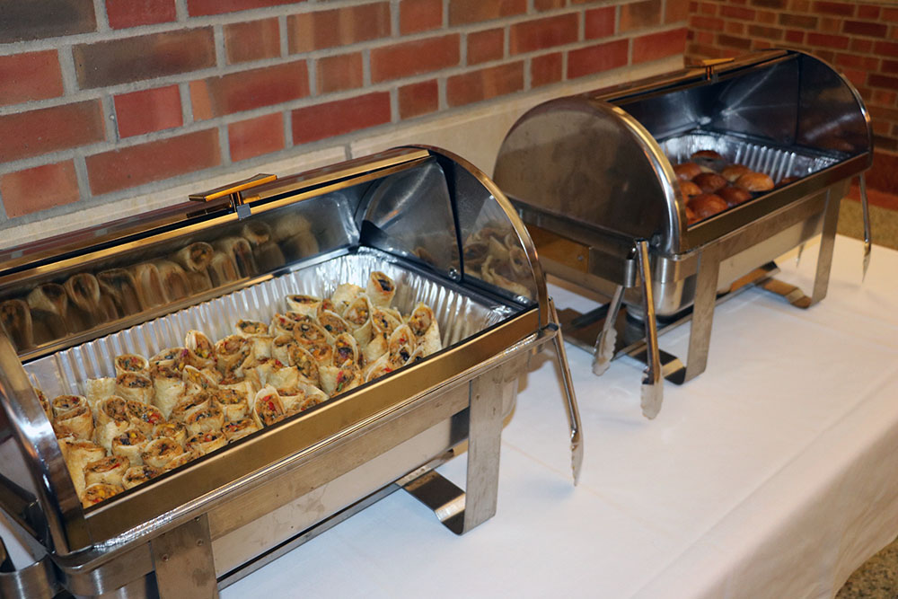 Two chafing dishes full of appetizers are pictured in the atrium of the Beckman Institute at the University of Illinois at Urbana-Champaign (UIUC)