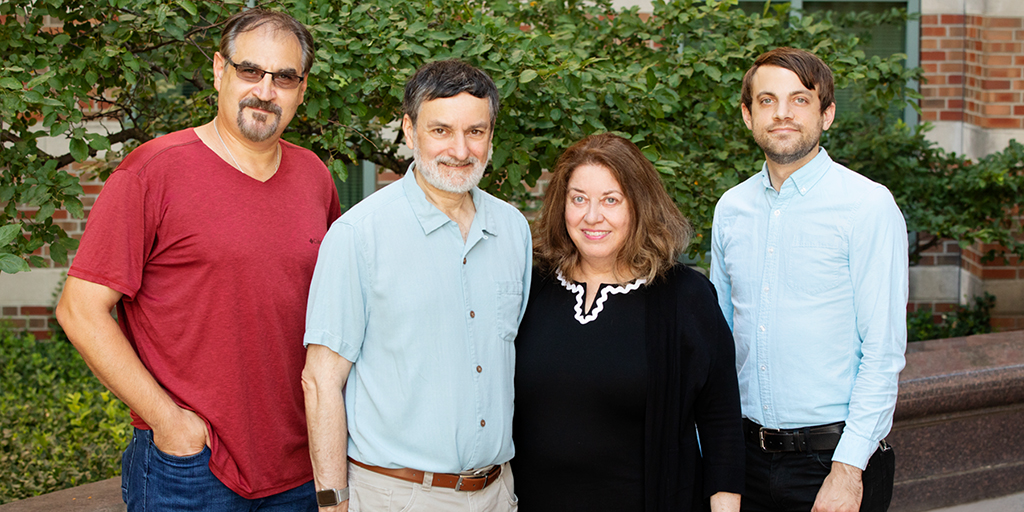 University of Illinois Urbana-Champaign psychology professors, from left, Florin Dolcos, Gabriele Gratton and Monica Fabiani, with postdoctoral researcher Matthew Moore, developed a new method to simultaneously image the brain using three technologies.