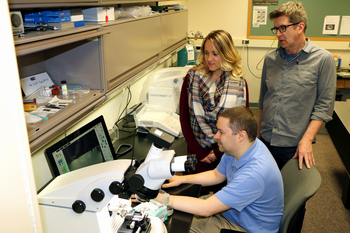 Members of Information Technology Services are in the Microscopy Suite assisting with a computer issue.