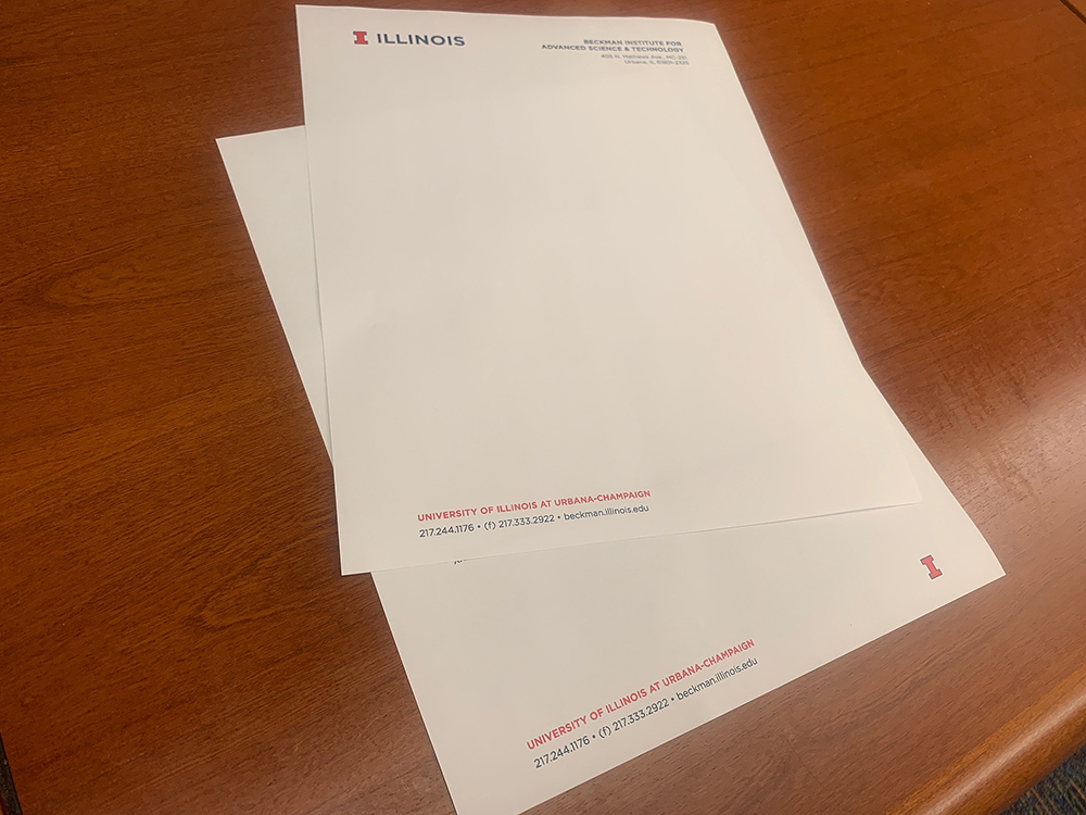 A photo of blank Beckman letterhead. It has the campus logo in the top left corner and Beckman's address in the top right corner.