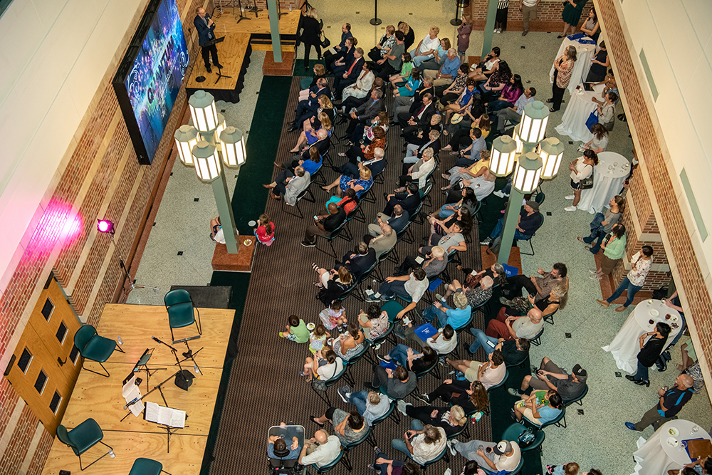 Beckman Director Jeff Moore addresses a crowd at the October 2019 performance of Quantum Rhapsodies at the Beckman Institute at the University of Illinois at Urbana-Champaign (UIUC)