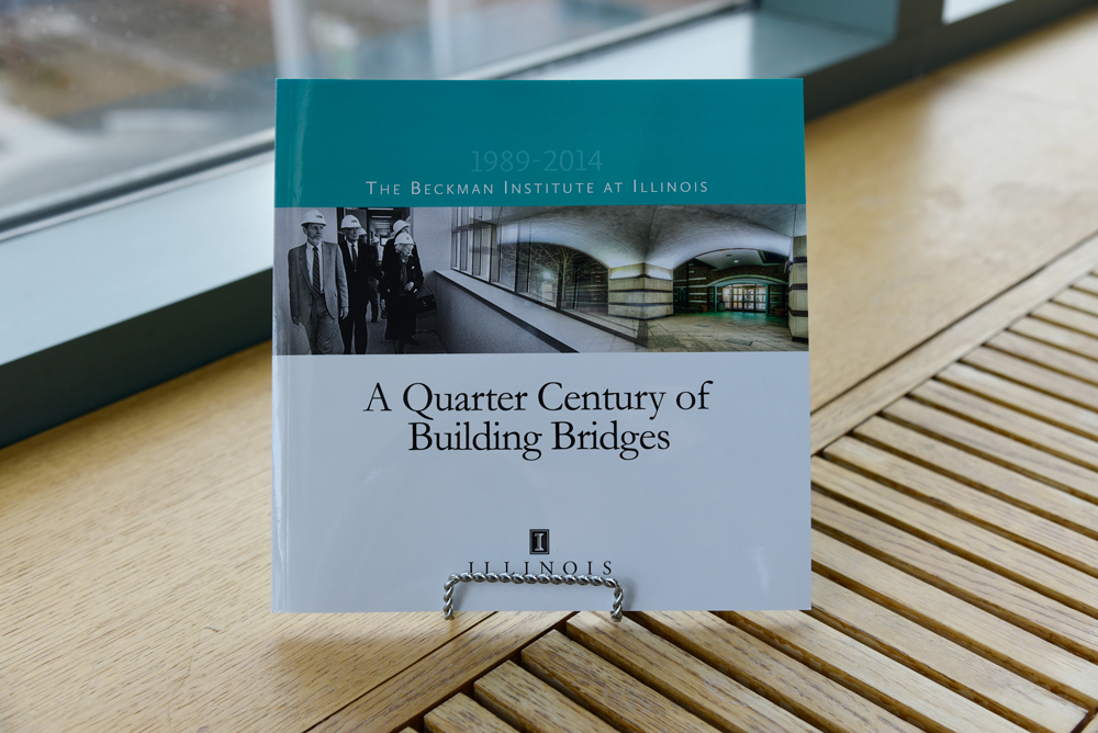 "The cover of the book, ""A Quarter Century of Building Bridges,"" which celebrates 25 years of the Beckman Institute at the University of Illinois at Urbana-Champaign (UIUC)"