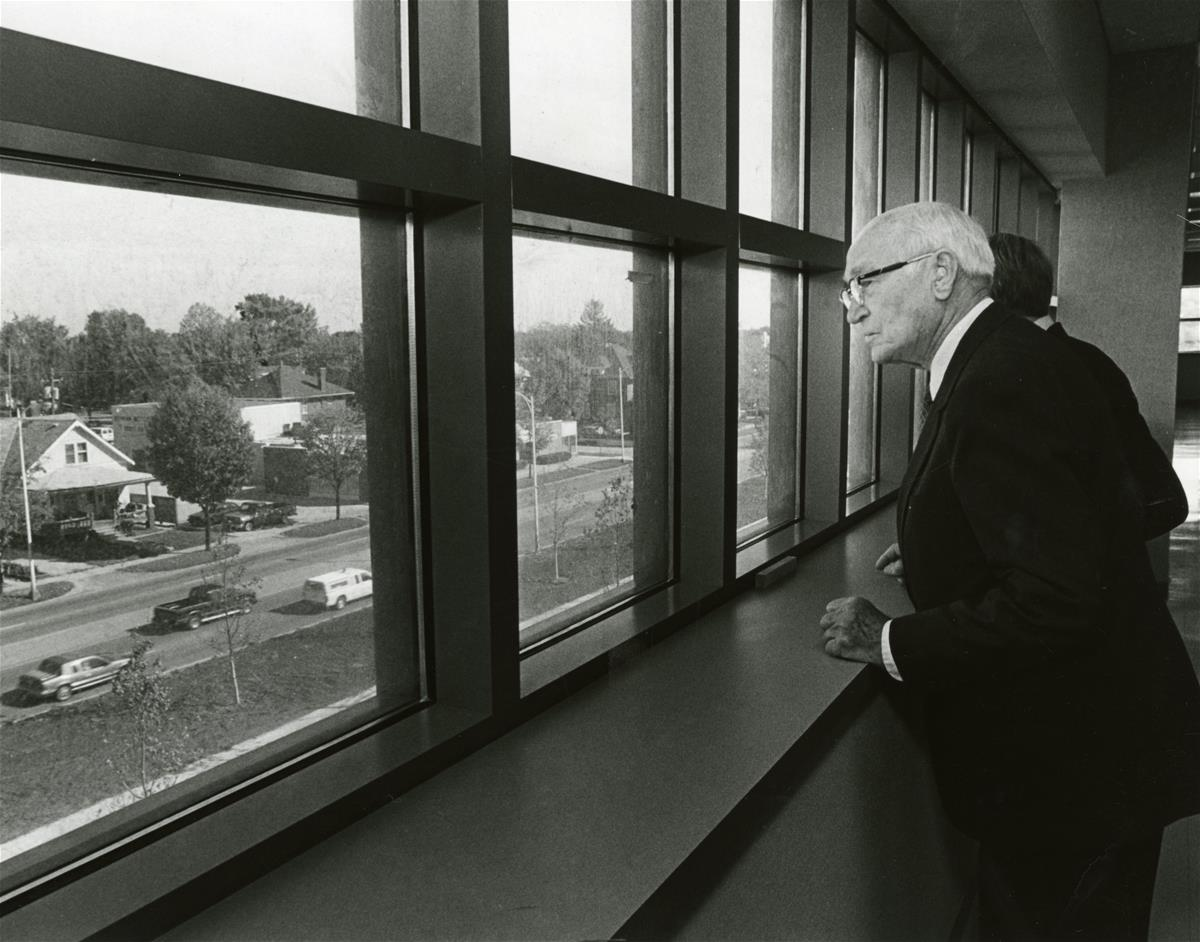 Arnold Beckman looks out a north window at University Avenue in Urbana during the construction of the Beckman Institute at the University of Illinois at Urbana-Champaign (UIUC)