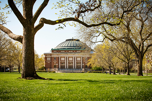 As seen from the Main Quad, Foellinger Auditorium appears stately and grand amid the autumn trees.