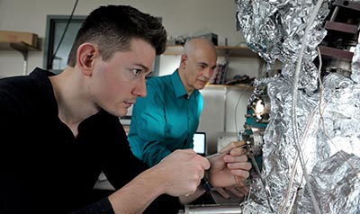 Adrian Radocea and Joe Lyding examine a sample nanoribbon.