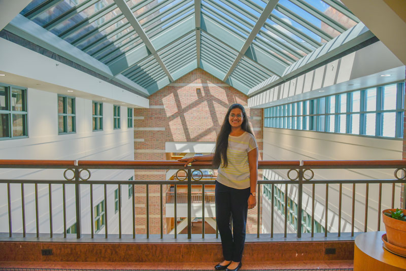 Standing on a bridge linking the north and south sides of the Beckman Institute, Shachi Mittal embodies her own desire to be a bridge between disciplines in her research.