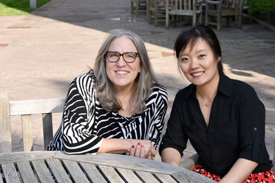 Researchers Liz Stine-Morrow and Xiaomei Liu are shown on the Beckman patio