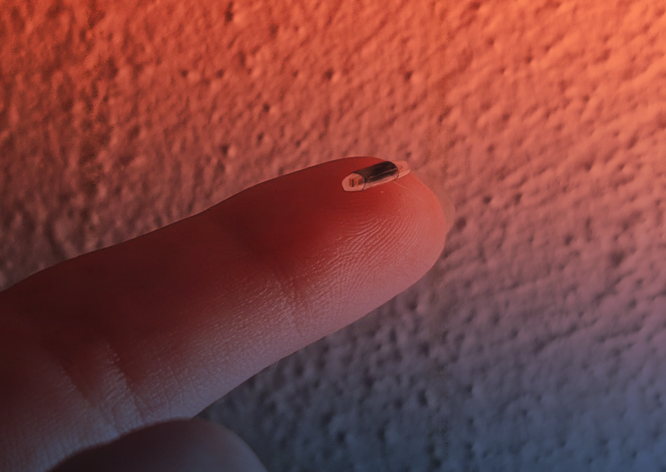 A radiological imaging clip developed by the team appears tiny as it is displayed on the tip of a researcher's finger.