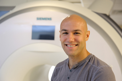 A photo of Beckman Institute Postdoctoral Fellow Ben Zimmerman in the MRI suite at the Beckman Institute.
