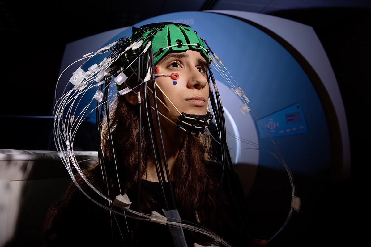 Julia Radu hooked up to an optical brain imaging tool
