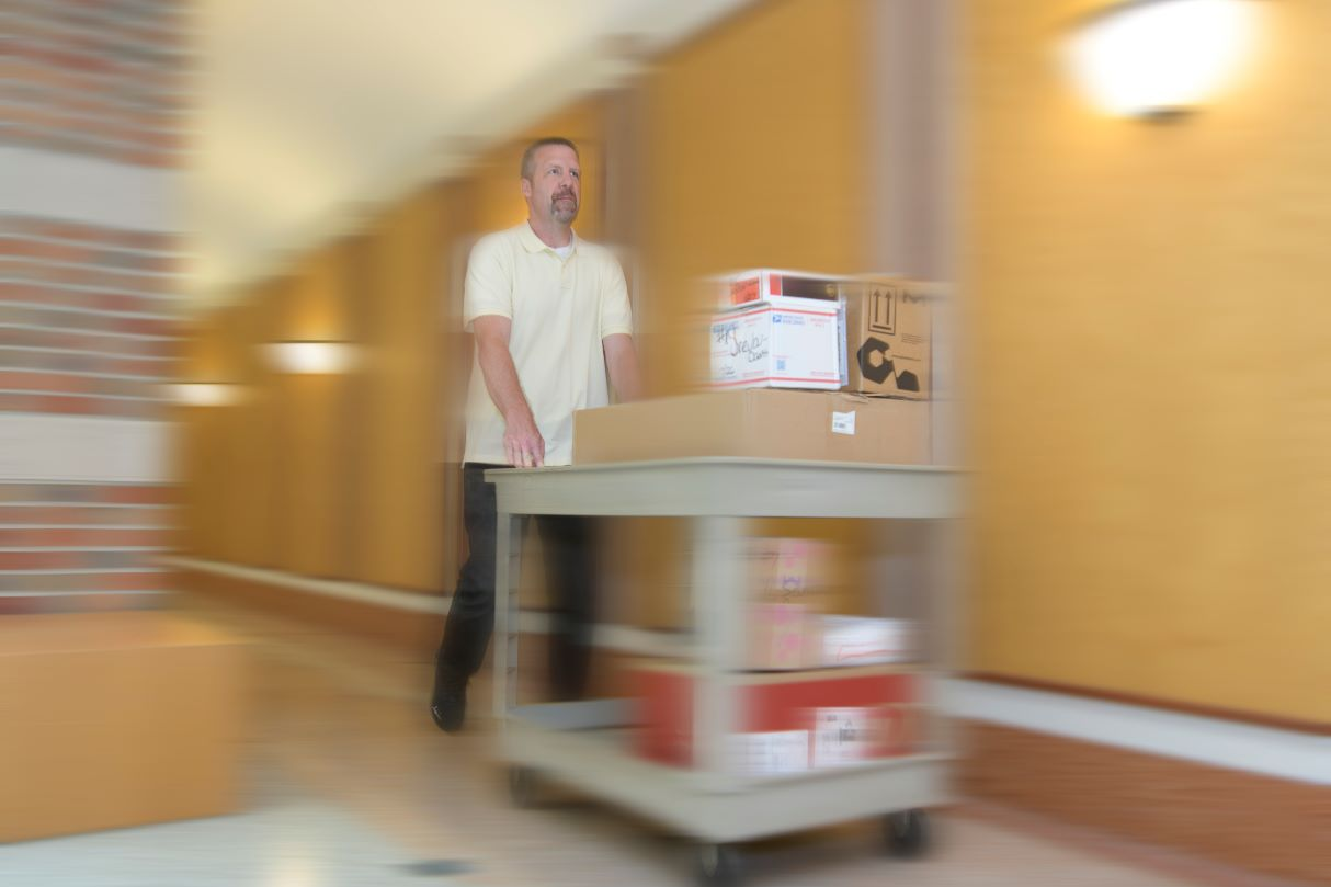 Ryan Wilson delivers packages
