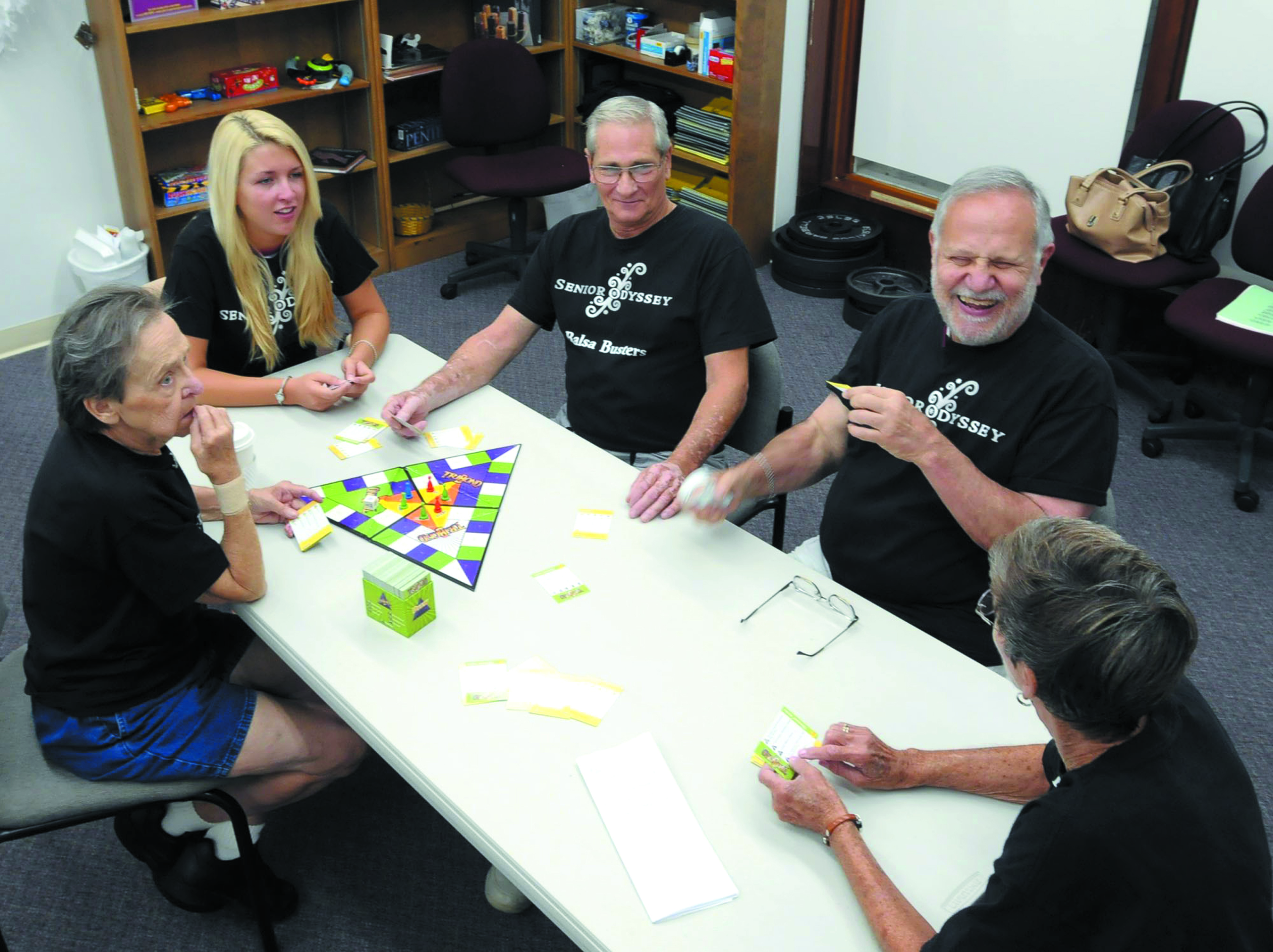 A group of adults sits around the table at the Beckman Institute